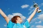 stock-photo-portrait-of-a-champion-celebrating-victory-against-blue-sky-143116909[1]
