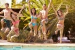 stock-photo-group-of-teenage-friends-jumping-into-swimming-pool-224122870[1]